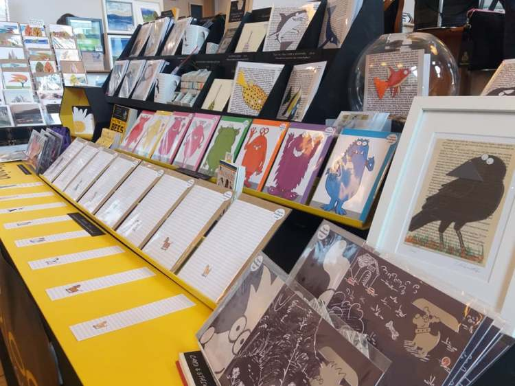 A stall displaying greeting cards in tiered shelving