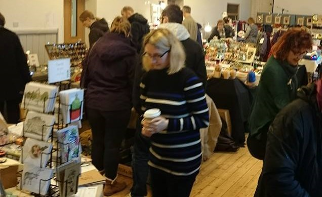 Picture of a craft fair with shoppers browsing at stalls