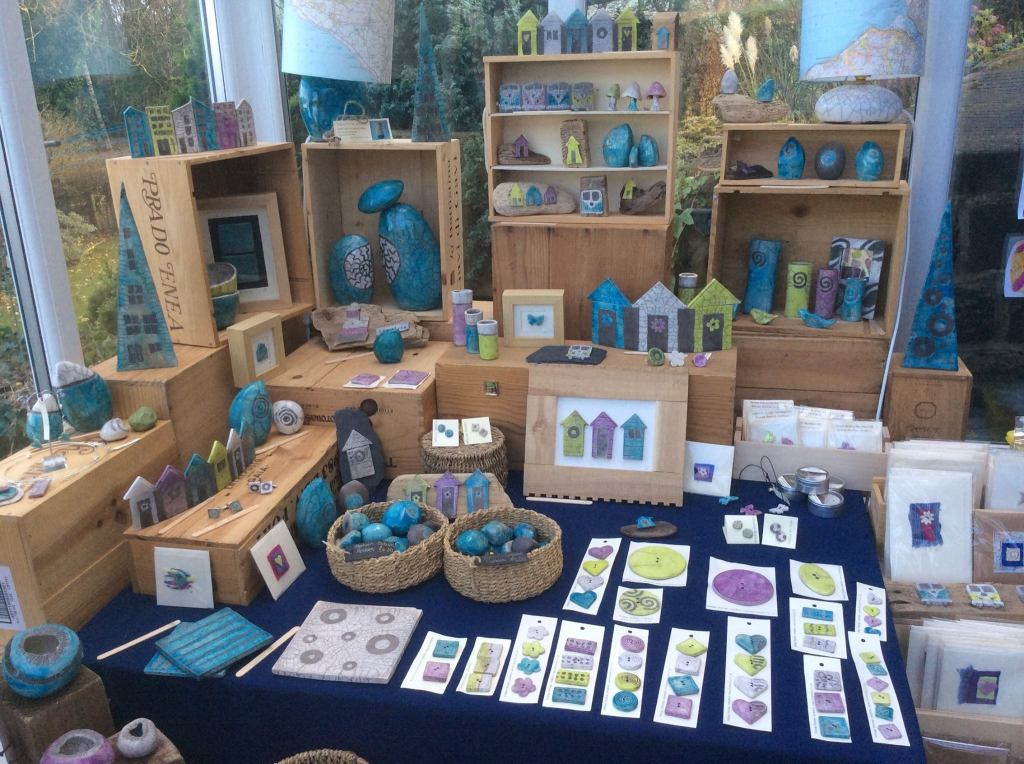 A stall selling beautiful coloured ceramic ornaments and accessories.