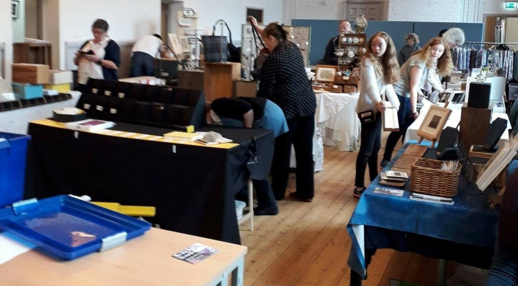 Stall holders setting up their stalls at a craft fair.